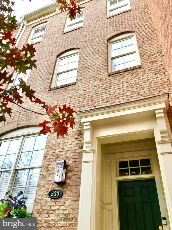 Beautifully renovated 4-level townhome located in historic Old Town, Alexandria. This ideally located home has been recently updated with high-end finishes and major appliances.  Its open floor-plan onto a private Travertine patio, makes it a perfect home to entertain your family and guests.  As you enter this stately townhome off of N. Pitt Street on the main level, the 10' ceilings with recessed lighting throughout, beautifully maintained hardwood floors, and abundant natural light through classic white-wood shutters, invite you into the grand living room.  As you continue just past the living room, the gourmet kitchen features stainless steel Bosch appliances and quartizite countertops. The adjacent dining and additional living room area, seamlessly open onto the outdoor patio and grill area. This is also your back entrance to the over-sized 2-car garage.  A powder room wraps up our tour of the Main Level of this home.  The lower level, with it's high ceilings, houses the recreation room/casual living space and a gas fireplace. You will also find a guest room and full bathroom as well as an abundance of storage on this lower level.   As we head  up to the 2nd floor of this lovely home you will find the spacious Master suite featuring two walk-in closets with custom shelving.  The luxurious master bath includes touchless mirrors with defrost, quartzite double vanity countertops, marble tile and flooring, a separate water closet with heated bidet and a glassed enclosed shower with a multi shower head.  On this 2nd floor you will also find a conveniently located laundry room and a private office.  One floor up, on the last and final floor of our tour, you will find a spacious den with floor to ceiling built-ins. On either side of den are two largbedrooms each with their own bathroom, and walk-in closets. This beautiful townhome property is a short walk to the waterfront, restaurants, Trader Joe's and other markets in Old Town as well as shops and parks.