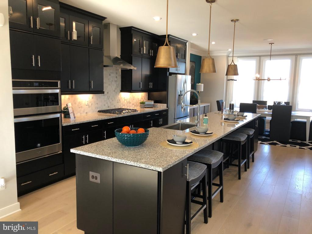 This beautiful 2600 square foot Covington interior unit Town Home includes a beautiful gourmet kitchen, luxury master shower, quartz counter top in the kitchen. We have a fantastic incentive packages on all our Quick Move In Homes! Stop by and see how you can own a new home before the holidays! Lot 134