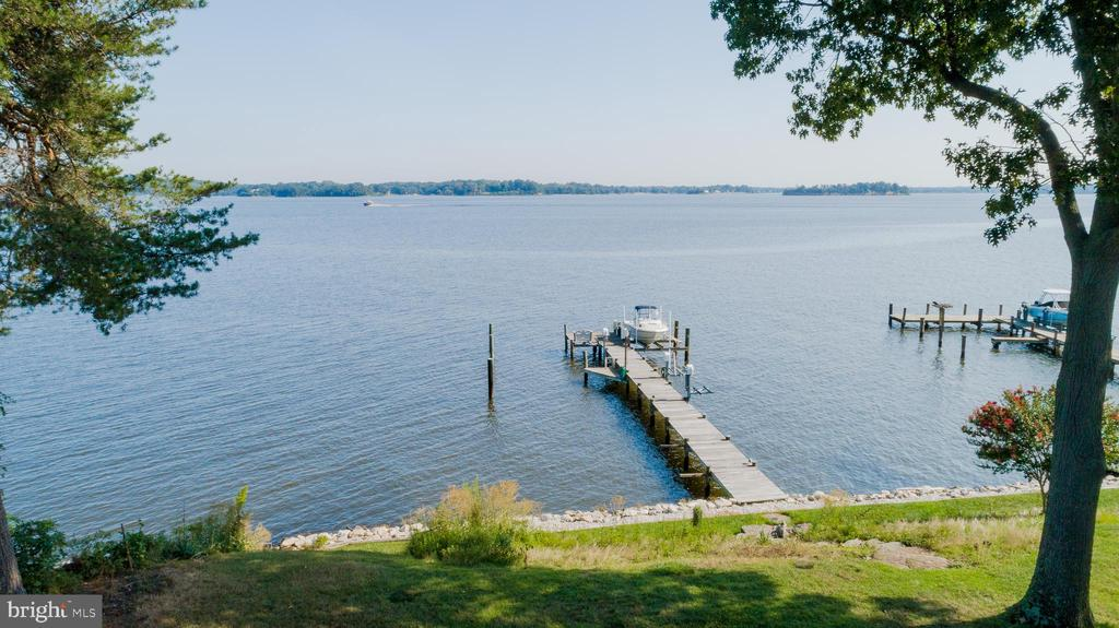 Beautiful custom waterfront home in the community of Bayberry on the Magothy!  Expansive river view with 100' of waterfront.   2 Slips,  includes 12,500 lb  boat lift and 3 jet ski lifts,  with water and electric on pier.   No flood insurance required.  Open floor plan and views galore ! Gourmet kitchen with Kitchen Aid warming drawer with  instant hot and cold water dispenser with filter at the kitchen  sink.   Spacious open living room with gas fireplace .  Master Bedroom also has gas fireplace and is open to the waterfront with a balcony overlooking  the river.   Master bath has sunken Jacuzzi tub,  enclosed dual shower heads with  Steam Mist steam shower and heated floors.   3 additional bedrooms upstairs with one large room that could be playroom or bonus room if desired.   Home also has lower 2nd Master suite with full bath ,  and an additional lower level bedroom.   Ceiling fans throughout,  also full house  Central Vac.  Home sits on quiet cul-de-sac .  Community of Bayberry has an adjacent  3 acre community beach with picnic area,  basketball court,   boat launch and slips.    Waterfront Living at it's finest!