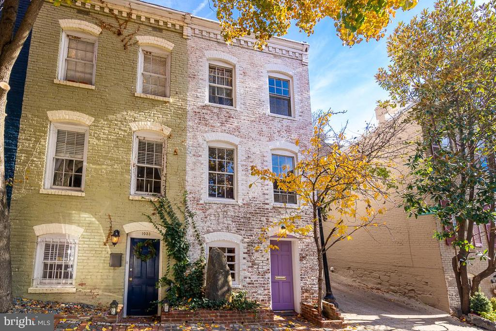 Built in the mid-1800s, 1033 Cecil Place NW is a semi-detached townhouse replete with Georgetown charm. The handsome original stone facade and ivy-covered walls complement the home's many period details and interior renovations. Notable features include exposed brick, two fireplaces, heated floors, recessed lighting, exposed beams, extensive custom storage and marble finishes throughout. A lush, secluded rear garden and patio with custom bar, seating with hidden storage and paved grilling area provides plenty of space for fair weather entertaining. A rare offering, the property is ideally located on a quiet, one-way street between the C&O Canal and Georgetown's waterfront park.