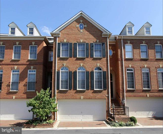 Stately BRICK front townhouse with 2 car garage, 4BR,4 1/2 BA, 2 MASTER BEDROOMS SUITES!  Walk to Old Town Alexandria with fine restaurants, shops, etc. adjacent to the scenic Potomac River, GW Bike/walking trail to Mount Vernon. Great Community with large swiming pool, tennis courts & TOT lot.  Spacious sunfilled rooms with large windows, French Doors & HIGH CEILINGS.  Too good to be a rental.
