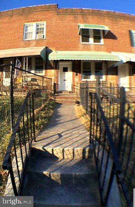 MAJOR PRICE IMPROVEMENT - VOUCHER TENANT PAYING $1255 PER MONTH!  Estate Sale - Recently Renovated Town home With Plenty Of Updates ! This Home Features An Iron Gated Front Yard W/Flower Bed/Garden Area And Awning Over The Front Porch.  Inside You Will Enjoy The Spacious Living And Dining Area. The Modern Kitchen Includes Granite Counter Tops And Stainless Appliances.  Hardwood And Vinyl Flooring Throughout, Partially Finished  Basement With New Half Bath And Walk Out To Fenced In Back Yard With One Car Brick Garage.   Perfect Starter Home Or Turn Key Rental. Very Close To  Highways, And Shopping, With Easy Access To Baltimore. Estate Sale Being Sold As-Is In Turn Key Condition.Tenant Occupied