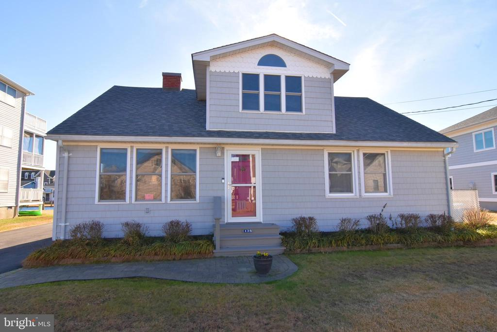 Complimentary 1 YR Home Warranty. Charming, Exquisitely Maintained 4 BD, 2.5 BA Canal-Front Cottage. Enjoy 2,300+ SQ FT of living space SITUATED ON A 7,405 SFT ( 0.17 Acre) OVERSIZED LOT - WHICH ACTUALLY IS 1.5 LOTS... leaving loads of room for buyers, including a DRIVEWAY ROOMY ENOUGH FOR 8 CARS OR SO. Owned by one family & Never Rented! They don't build them like this anymore. Large Living Room sports OAK FLOORS, and TONGUE-IN-GROOVE, KNOTTY PINE PANELING WITH A PICKLED FINISH THAT CONTINUES INTO THE KITCHEN AND HAS BEEN REFINISHED TO LOOK LIKE NEW. There's also a wood-burning fireplace, loads of light and a ceiling fan. This home has enjoyed year-round care & meticulous maintenance over the course of two generations - leaving it move-in-ready for a lucky buyer. Roomy Kitchen includes Breakfast Bar, like-new appliances, lots of cabinet space & upgraded vinyl floors (that look like tile) that continue into a Huge Sunroom (w/ ceiling fan) facing oversized backyard, canal & dock. Loads of storage in Kitchen & thru-out the house w/ ingenious built-ins located under stairs, in the eaves upstairs & elsewhere. Sunroom, w/ ceiling fan, also is flooded w/ light from large windows & sliding glass door on 2 sides. Sunroom's Anderson windows include Mylar shades for added insulation & reduced glare in winter & summer alike. 3 Bedrooms & 2 Full Bathrooms downstairs plus Laundry Room. Large Bedroom area upstairs includes Half Bath & Sitting Area that views New Castle Drive thru an over-sized dormer. To keep warm in winter, each room has its own separate (Heating) Thermostat to adjust its baseboard heat. Outside: large tool shed, outdoor shower & storage for beach chairs, umbrellas & toys. Crawlspace insulation replaced and weatherproofed in 2013 with waterproof spray foam insulation. So much more to see! Short walk to Beach. Call for a showing. Don't miss this Beautiful South Bethany Cottage because you will not find another one like it! Priced to Sell at $645,000!