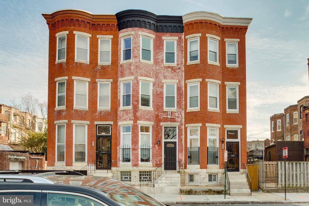 "This beautiful ""swell front"" rowhome Located in historic Reservoir Hill is one of only 3  front facing  homes located on the entire block.  The home backs to the cozy and colorful Madison Ave Park, and located less than 1 block  from the historic Druid Hill Park, which is undergoing a massive restoration. The house boast Exposed Brick, Cast Iron Stair Railings, 2nd Floor Recreation/Media Room with Deck,  Dual Zone central a/c and heat are just a few of the home's features.  Close to both MARC train stations, West Baltimore, less than a 10 minute drive and Penn Station, a 15 minute walk. 5 minute walk to the Subway and walking distance to Light Rail Stations and MICA. Less than a 5 minute drive to R house, the hip food hall, grocery stores and other amenities. This home may be eligible for a $10,000 Vacant to Value Grant and other Baltimore City Homebuyers incentives. Buyer to verify.  Reservoir Hill is a community ""booming with opportunity"", come and be a part of the Reservoir Hill Renaissance!"