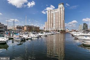 Breathtaking views of Baltimore~s  Inner Harbor and the city skyline from the this 16th floor unit.  All within walking distance of the Inner Harbor.   Features 2 bedrooms, 2 full baths with a magnificent view from each room. Each bedroom has its own  cozy balcony.  Hotel-like amenities include 24/7 front desk concierge, gym, indoor & outdoor pools, sauna, meeting room and more.  This unit has access to one leased parking space and boat slip if available.  Excellent location near downtown business district, transportation, stadiums, nightlife, and shopping! A MUST SEE!!  Above grade finished square feet is estimated.