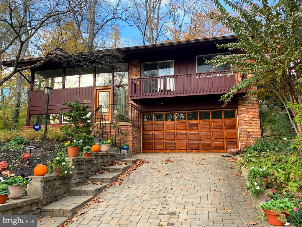 THE LIGHT & SPACIOUS DESIGN FEATURES of the  Mid Century modern era -just renovated with New Roof, New Stainless Appliances,  New Granite Counters, New powder room, Hardwood on main level refinished, Recessed lighting,  Cathedral Ceilings, and many more features!  Must see to appreciate!  Current owner added to the Kitchen and Breakfast area, and put a Laundry , extra closets, and an Expansive Master Bath Retreat.  Relax in the  Glass walled corner spa, with a serene view of a waterfall and pond.  Custom etched glass doors highlight your large shower. A wrap around Patio is a perfect place for cool summer evenings - and you step up to your own separate Sauna in the back corner!While the home is beautiful it also has the practicality of an oversized 2 car Garage with a workbench and storage that exceed your wildest dreams! A separate spare Freezer and Fridge reside in the Lower Level utility area. The Rec Room has built in cabinets and a fireplace with a wood stove insert. This Private Oasis could be yours in the convenient, sought after Hillmead minutes from downtown Bethesda, Montgomery Mall,  270 & 495!!