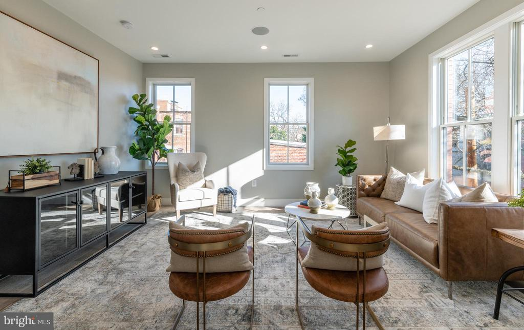 New Construction Penthouse in Logan Circle   2 Bed   2.5 Bath   1,400 Sf  Private Rooftop Deck w/ Monument Views   Building: Boutique Building, 4 Units, Built-in 2019, Developed by Cannon Development   1 Parking Space for Sale $40k   Units: Separate Living & Dining Spaces, 4'x12' Motorized Skylight Hatch Leading to Rooftop Deck, Lots of Natural Light, Built-in Audio System, Nest Doorbell & Thermostat, Recessed Lighting, Open Floor Plan, Powder Room, Electrolux Front Loading Washer & Dryer   Kitchen: Kitchen Island w/ Storage & Seating for 4, White & Maple Custom Cabinetry, Restoration Hardware Lighting, Under Cabinet Lighting, Quartz Counters, Bosch Stainless Steel Appliances, Full Size Dishwasher, Black Finishes   Baths: Double Vanity & Water Closet in Master, Marble Backsplash in Master, Subway Tile Backsplash w/ Built-in Niches in 2nd Bath, Vanities w/ Marble Counters & Storage, Mirrored Medicine Cabinet, Full Size Tub, Kohler Fixtures & Toilets