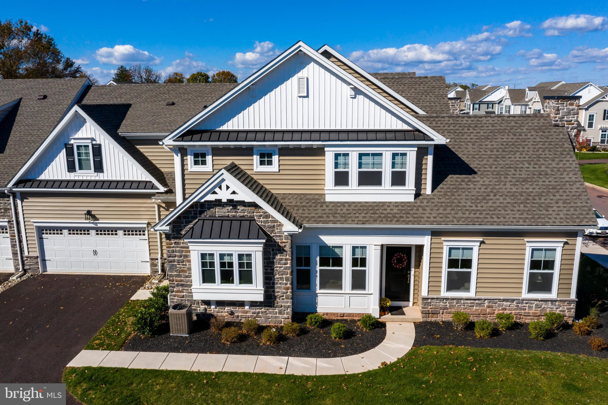 Your own personal luxury oasis awaits in this magnificent carriage home in award winning Spring Ford Area School District. This 3-bedroom 2.5 bath home has all the upgrades and amenities you could need to give you the feeling of resort living. Enter through your front door into the open floor plan and you are immediately drawn to your living room complete with 14-foot vaulted ceilings, breath-taking floor to ceiling stone fireplace with raised hearth and windows galore. In addition to your gorgeous views enjoy your morning coffee off your private deck. This room features a custom built in desk that was a $4500 upgrade. This room also boasts a two-foot bump out to give you additional space and comfort. If you enjoy entertaining this open floor plan is enhanced perfectly for you with the built in speakers in both the living room and kitchen. Make your way into the gourmet kitchen with dark espresso cabinets, granite counter tops and stainless-steel appliances. This home has a custom back-splash and double drawers under the gas cook top to give extra storage. The side panels on all cabinetry add to the style and sophistication that any homeowner would dream of in luxury living. The first floor holds the master suite with His and her closets. The walk-in closet is large enough to look like another bedroom with its ample storage and space. You will immediately be pleased with the master bath with over-sized walk in shower that has upgraded tile and fixtures. Your double bowl vanity is seamless for keeping all your essentials tucked away. Ascend upstairs to 2 additional bedrooms and bathroom. The bathroom has direct access from the hallway as well as the 3rd bedroom. Each room has a nice sized closet and offer plenty of privacy and space. If it~s an additional bedroom you seek you will find an unfinished area above the garage complete with electricity and insulated flooring making this room simple to finish if you desire. The loft area on this level completes the space and gives you another area where family can gather or use as an office. This home is only one year young, and all utilities and appliances are from 2018. You get all the comfort of a new home without the wait! Don~t delay in scheduling a tour and fall in love with your forever home.Buyer will be offered a 1 year House Membership to Spring Ford Country Club does not include monthly minimum food cost.