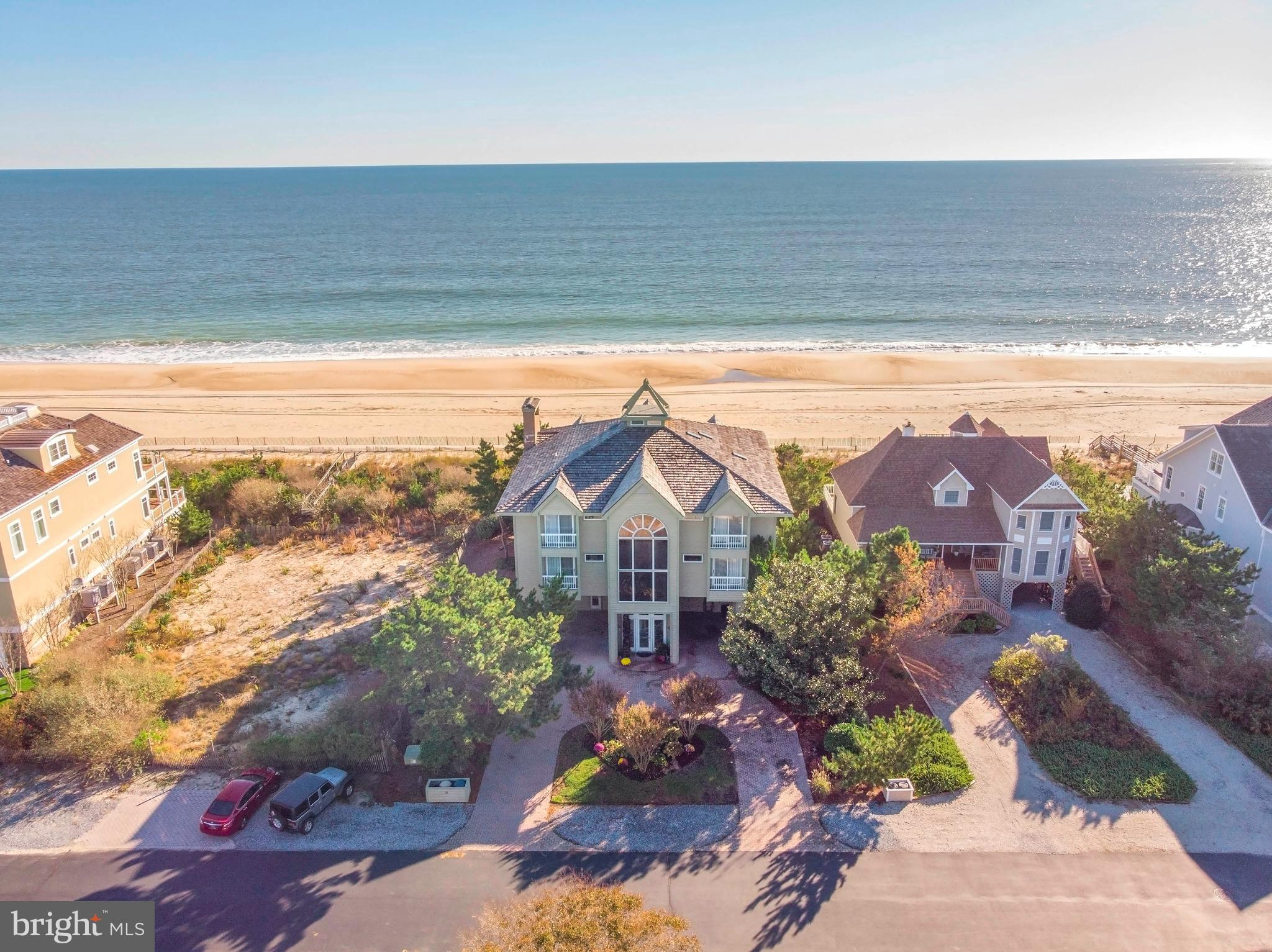 Welcome to the Pinnacle of Beachfront Living. Now is your opportunity to purchase one of the paramount properties in all of Delaware, offering spectacular ocean views with direct private beach access. Situated in a private, gated community in Bethany Beach which is known for its beautiful beach and dedication to providing a clean, safe, family atmosphere. This home boasts 8 Bedrooms(six w/en-suites) 8 Baths and 7000 sf of interior living space. Enter this quality constructed, custom built oasis by way of the soaring grand foyer. Ascend a few steps to the first floor which has the feel of a Casita or In-Law Suite with it~s spacious bedroom retreat, en-suite w/his and her closets and privacy of being the only bedroom on this floor. Convenient hall access to the Sauna, changing room, laundry room and direct access to the lower deck area. The lower deck offers an expansive breezeway, two outdoor shower rooms, large beach accessory storage room, a tranquil covered sitting area and direct beach access. The utility/mechanical room completes this level. The main level offers dual front facing bedrooms, each with a private balcony, large en-suite, walk in closet and double sink vanity. In addition, there is a third bedroom with close access to a half bath. The stunning 2 story Great Room boasts a cohesive blend of granite stonework and tasteful finishes to create an inviting gathering area complete with glorious ocean views. The open dining area connects to the expansive eat-in kitchen that features endless granite countertops with matching backsplash, stainless appliances, tons of cabinet storage and bright skylights over the inviting eating area. The massive main deck provides plenty of space to entertain, relax or simply to soak up the sun.  Head up to the top floor where you will find two additional front facing bedrooms each with their own balcony, en-suite and walk-in closet. Also find a bonus room currently being used as the eighth bedroom but could be used as a home 