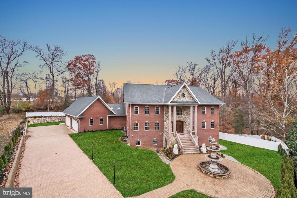 Just Listed & a rare find: Grand 13,000 sq ft 7 BR / 7 BA custom-built residence with 4-car garage recently completed in 2017 and sited on a 1.77 acre private lot in McLean. Gated entry leads to large driveway and gracious fountain in front of the impressive entry to the home through custom double front doors. Striking two-story foyer with curved dual staircases. Custom and exotic finishes and features are adorned throughout: marble, onyx, granite, rich hardwoods, and custom trim & moldings. The gourmet kitchen offers an island, two sinks, stainless steel appliances including 6-burner Thermador range with pot-filler, and exotic counter tops with herringbone laid stone back splash. Inviting living room, formal dining, rear great room, and main level bedroom / office offer great functionality. The huge mudroom leads to a 4-car garage that is perfect for safeguarding your prized vehicles. Upper level 1 features 4 bedrooms, each with their own en-suite full bathroom, including a superb master suite. Laundry is conveniently located at the bedroom level and lower level. Upper level 2 offers plenty of possibilities: additional bedrooms, finished storage space, additional rec or fitness space, etc. The fully finished basement is perfect for entertaining with a wine bar, wet bar, multiple rec room areas, theater room wired for surround sound, full bath, and separate bedroom with en-suite full bath that can be accessed via separate entrance. The expansive 1.77 acre lot backs to woods and offers abundant possibilities for the flat rear yard including ample room for pool, tennis / sport court, etc. This unique property has barely been lived in, offers unrivaled value plus tremendous potential. Make it yours now!