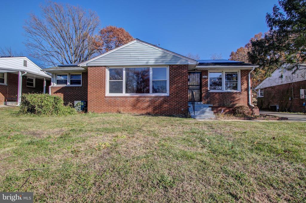 Wonderful opportunity to rehab this 2-level brick rambler with full basement, 4 bedrooms and 2 full baths, off-street parking, wood burning fireplace, wood floors, separate dining room all situated on the deep wide lot.  Bring your contractor with you as this is a great investment. Multiple offers received.  Please send highest and best.