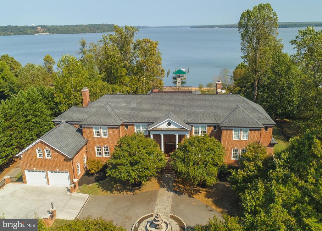 This Georgian style waterfront estate is truly remarkable. The home is situated on Mason Neck just outside of Alexandria in Lorton, Virginia. You are only 40 Minutes to Washington, D.C. and 30 Minutes to the heart of Alexandria. One of the nicest true beachfront properties within close proximity to Washington. The home is comprised of over 16,000 sq ft++ of living space on nearly 7 acres of land partially enclosed in paddocks. The property features gated and secured access with top of the line surveillance systems. The home was built in 2003 and no expense was spared. Recently upgraded with state of the art smart home access, the home can be operated from your mobile device or ipads distributed throughout the house. This includes everything from the cameras to the channel on the television. Featuring a first-floor master, library, dining room, family room and gourmet kitchen on the main level. The second floor features a game room, rec room, office, full gym with sauna and a dressing room with space for a spa. The lower level features an in-law suite or maids quarters, multiple rec spaces and a state of the art theater. There are two garages, one accessed from the motor-court and the other from the side of the home. The side entry garage is oversized and has an attached workshop. There is road access to your beachfront for quick and easy access to your boat. Contact us today for a private showing and to learn more about this estate. The home has recently completed interior painting and updates.