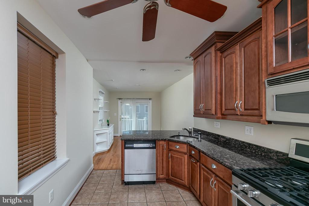 Live in the heart of lively, happening Riverside/Federal Hill, but on a quaint, tree-lined street! Built in 1867, this elegant townhome offers all the best that Federal Hill has to offer. This home is steps from beautiful Federal Hill Park, the newly revamped Cross Street Market, as well as the colorful area restaurants and bars. Walk to see Orioles and Ravens home games, or take the bike path that surrounds the Inner Harbor for a day of fun adventure. And when you've had enough fun, this home offers the respite that any weekend warrior craves, with the rare convenience of a two-car parking pad. The gas fireplace will warm you on snowy days, and the large floor plan and extended living area offer plenty of space for dinner parties and warm gatherings. The living room features exposed brick, crown molding, and the home's original cherry hardwood floors, offering the perfect mix of classic and modern. It flows through the dining room into an updated kitchen with stainless steel appliances, a brand-new gas range, granite counters, and a sunny family room with a breakfast bar. The second floor boasts a HUGE bedroom with light and space galore, a smaller bedroom or office, and a beautiful, freshly-painted bathroom complete with a dual-sink and jetted tub. The private master suite encompasses the entirety of the third floor, offering the perfect escape - and is complete with an independent HVAC system for maximal comfort during the dog days of summer in the city or chilly winter nights. The city is full of opportunities . . . and so is this home. Submit your application today! Apply online: https://spree.rent/gh8mq.