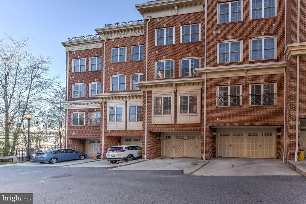 Baltimore's most luxurious townhome, in one of its most coveted neighborhoods, features a rooftop patio with spectacular views overlooking the Inner Harbor and Baltimore skyline. Enjoy the space, light, and upgrades throughout all five levels of this gorgeous home, all accessible via in-home elevator finished in wood paneling.  The first floor contains a bonus room, perfect as an office, home gym, or game room.  The expansive second floor open floor plan includes 10' ceilings and an impressive Great Room perfect for entertaining, with a powder room and space for all your family and friends.  The fully equipped eat-in kitchen contains granite countertops, 42 inch cabinets, stainless steel appliances, gas cooking and a center island.  The third floor has two bedrooms, two bathrooms, a separate laundry room, and another bonus space you can make your own.  The fourth story Master Suite features a Walk-In Closet, a spa-like bathroom with a Jacuzzi Tub, and a Wet Bar, with easy access to the rooftop patio.  Parking is always convenient, with a 2 Car Garage, 2 Car Parking Pad, and access the private parking on Belt Street reserved for Federal Place residents.  In addition to featuring sweeping views of the waterfront and skyline, the large rooftop patio has plenty of space for lounging, enjoying your favorite meals straight off the built-in gas grill, and rooftop gardening.  Whether you are enjoying a front row view of the New Year's and Fourth of July fireworks, or relaxing with a glass of wine in the evening, there is no better view.   Federal Hill is one of Baltimore's most popular neighborhoods, and you will love being steps away from many restaurants, shops, and several beautiful parks.  Truly city living at its finest!