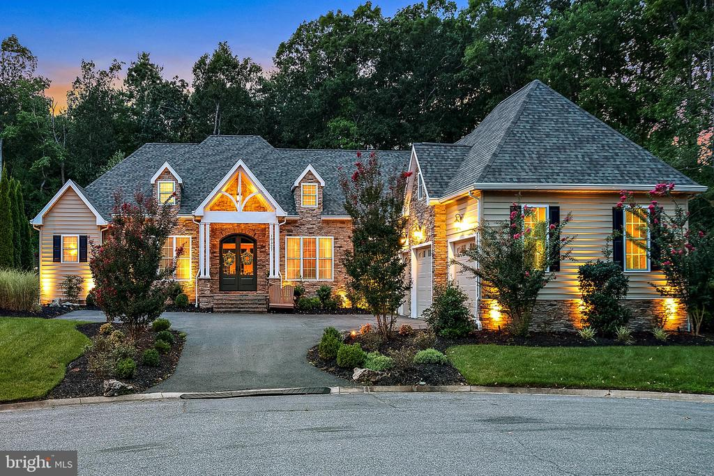 Stunning custom built home in desirable Bay Point Plantation. This community is surrounded by a 142 acre nature preserve with trails, marina, and a one of a kind waterfront location with skyline views of Ocean City. Included is deeded boat slip #18. This residence is situated on a premium cul-de-sac lot and well-appointed with every upgrade imaginable. You will love the soaring ceilings, abundance of natural light throughout, and open floor plan with most rooms on the first level. Features include hand scraped bamboo hardwood floors, two gas fireplaces, gourmet kitchen with stainless appliances, upgraded counter tops, island with hammered copper sink, walk-in pantry, separate butler's pantry with wine cooler and ice maker, climate controlled storage and so much more! The spacious Master Suite offers tray ceilings, heated tile floors, stacked stone shower, and a generously sized walk-in closet.  Enjoy the gas fire pit, paver patio, and 10 x 20 gazebo. All perfect for entertaining outdoors. There is an attached 3-car side entry garage with an additional parking area in driveway. This immaculate property is just minutes to Assateague Island and Ocean City beaches, as well as downtown Berlin.