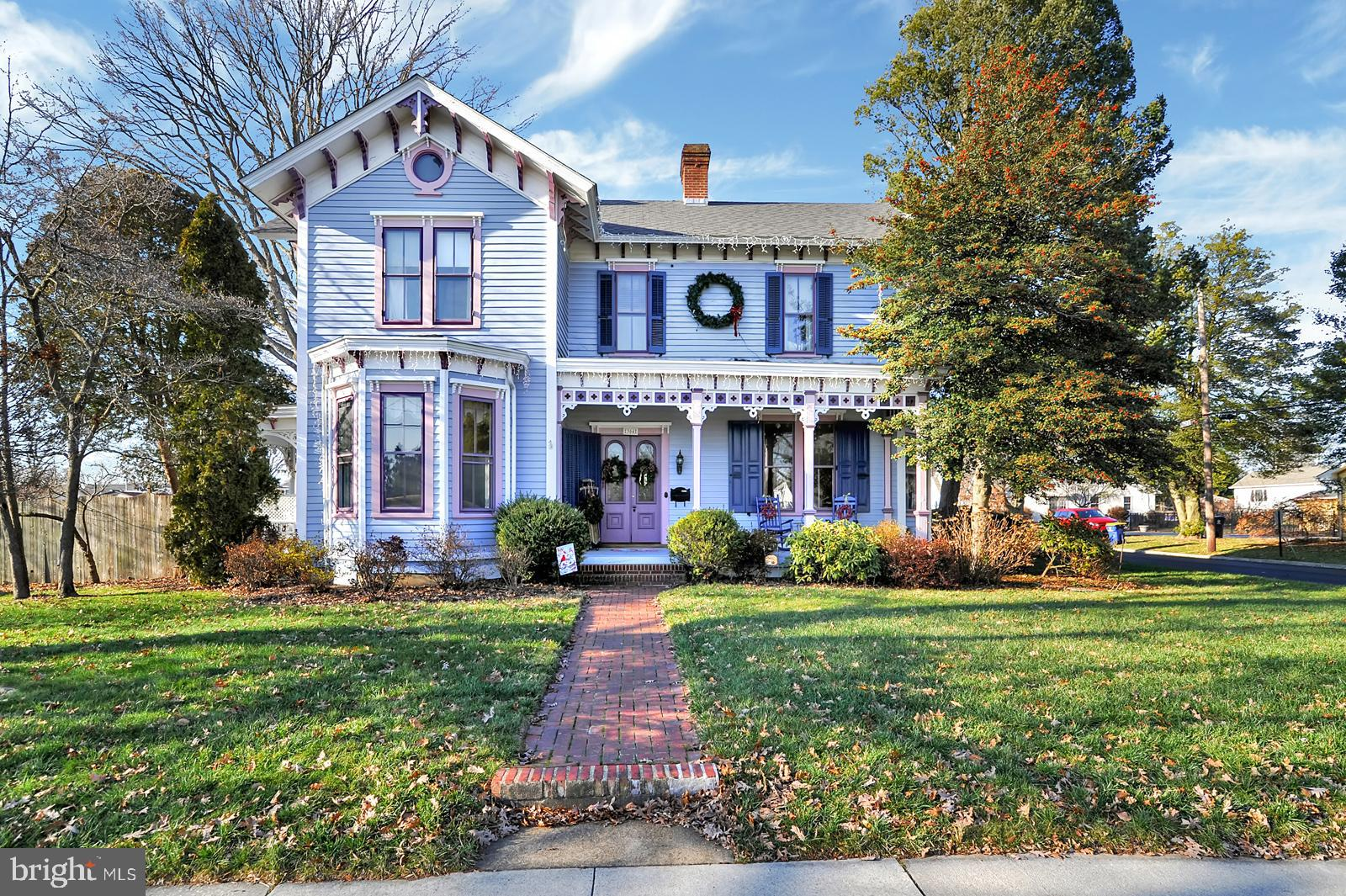 """Absolutely stunning restored Victorian home in the heart of Smyrna that is listed on the National Historical register! This home has been lovingly maintained and updated. The large welcoming front porch leads to a warm and open foyer with beautiful, pine, wide-plank, refinished, hard wood floors and a sparkling crystal chandelier. To the left you will find a large, well-appointed family room with a walk out bay window that still has the original plaster moldings and custom-made antique wood shutters, and fully functioning black marble fireplace. Across the hall is the Billiard room with a fully functioning white marble fireplace, antique light fixture, and walk-out bay window with the same original plaster moldings and antique wood shutters. The wood flooring throughout the first floor has been recently refinished as well as the front staircase and the second floor hallway. Most of the first floor has been recently repainted and features 11 foot ceilings, 8 foot ornate, solid wood, interior doors, original hardware, and crown molding. The large, formal dining room features a brick fireplace with a gas log insert, and access to the charming  """"wedding cake"""" side porch.The kitchen has been relocated and completely transformed! There are white raised-panel cabinets, a gas range with an exhaust hood, side by side stainless steel refrigerator, wall oven, dishwasher, built-in shelving, glass-front cabinets, granite counter tops, a window seat, and a wood ceiling. There is also access to the unfinished service basement. Just off the kitchen, a French door leads to a first floor office. You will also find a laundry room, full bath, and mudroom that leads to the HUGE garage with a walk-up attic storage space.The second floor master bedroom offers another brick fireplace, double closets, a window seat, and beautiful wood floors. There are three more bedrooms and two full baths upstairs and a second staircase that takes you back to the first floor.Outside you will find an enorm"""
