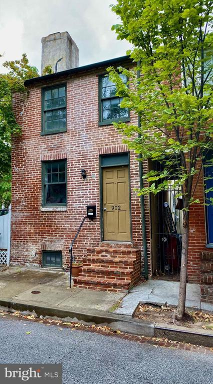 A REAL GEM in Historic Mount Vernon on a very noteworthy street within a stones throw of wonderful restaurants, shops, historic museums and parks, the Baltimore School for the Arts, the Peabody Conservatory, MICA, Center Stage, the Meyerhof, and Penn Station!!!Totally renovated with all of the charm you would expect in this quaint, all brick, end of the row townhouse.Brand new gourmet kitchen which leads to a private garden, 1 Full, 1-1/2 New bathrooms, and ample sized bedrooms.Hardwood flooring throughout.  New windows to conform to historic preservation.Seller will consider a parking space, for one year, with acceptable offer.