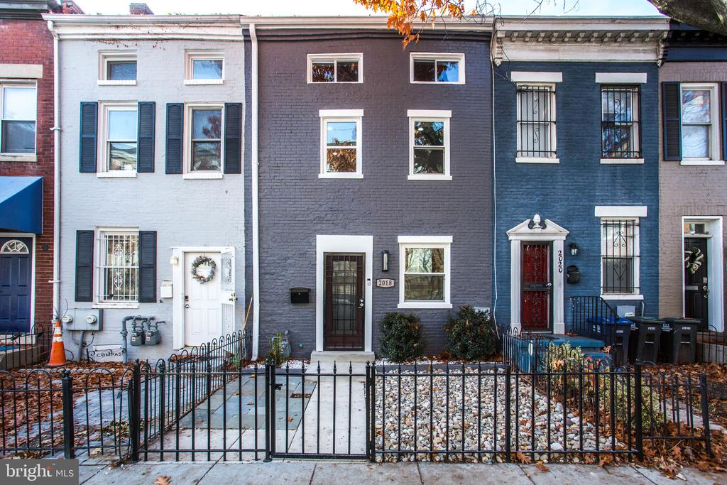 2018 10th Street, NW is a renovated and well-maintained Federal Townhouse just off the U Street Corridor in Logan Circle.  The NEIGHBORHOOD...Just steps to 2 metro stations:  U St/13th and Shaw/Howard University metro stations.  Additionally, the property is located 1 block from a brand new WHOLE FOODS coming at V St/Florida avenue in 2020.  Just a short walk from several music venues and Restaurants. The HOUSE...2000 SF of Living Space  Main Level:  large Open Living Room/Dining Room with the Kitchen and breakfast island in the rear and powder room.  The house comes with Nest Thermostat, ADT Security Package, security camera, doorbell, new plumbing system, HVAC and electric lines.  The kitchen comes with state of the art Samsung appliances and touch activated farmhouse sink.  The countertops are a natural selection Dekton Entzo, allowing for maximum durability and design.   The kitchen exits out to the patio/garden and parking. The Second floor has the master bedroom, second bedroom and laundry.  The Master Bedroom comes with a private bathroom, private deck and walk in closet.  The hallway bathroom comes with a marble vanity and bathtub.  There is an extra hallway closet and Washer/Dryer.The Third floor comes with a large bedroom, which accommodates a queen size bed-set and a 5' closet.  There's also a large marble bathroom, office nook and 2 more closet/storage spaces.