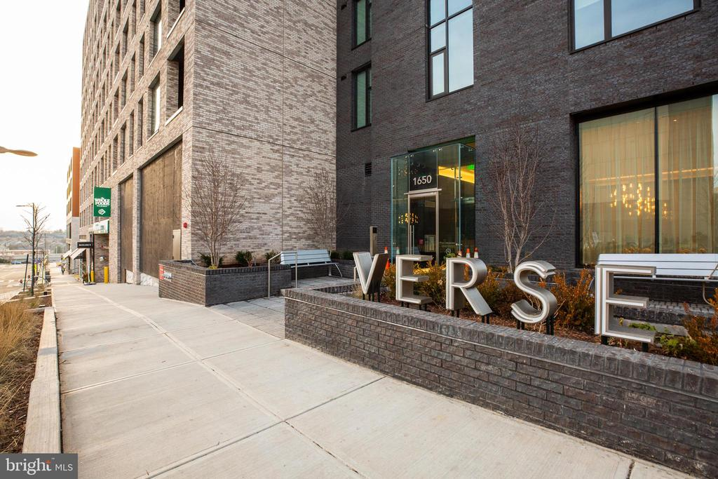 Welcome to The Verse. Tysons New Luxury Condos at The Boro, built for the Elite and Sophisticated. Walk into this Sun-Drenched 1,800+ sqft 2 Bedroom + Den Unit that comes with 2 Garage Spaces, SEPARATE Storage unit & 3rd RARE ELECTRIC vehicle charging space ($100k value) Designed with high-end Italia Cabinets, Panelized Bosch Fridge, Bosch Gas Cooktop and Quartz Countertops. Take Advantage of the Full Service building which boasts 5-star Amenities such as 24 Hour Concierge, Fitness Center, Indoor & Outdoor Yoga Studio, Swimming Pool, Guest Suite w/ Hotel Amenities & More.  Enjoy nights stargazing or watching movies on the exclusive One Acre Sky Park. Entertain on the Expansive Private All-Season Terrace with Communal Tables and Cocktail Seating. Prime Access to the Silver Line with retail and hospitality neighbors including Whole Foods 70k SqFt Flagship Store, Icon Movie Theater, Multiple Restaurants & Boutique Shops. Enjoy World-Class Living Perfectly Crafted For You.  Garage Parking Spaces on the 8th floor  #145 & #146 & Storage Level 8 #5.  ADDITONIAL RARE ELECTRIC CHARGING SPACE AVAILABLE FOR PURCHASE $100k (Deeded separately)