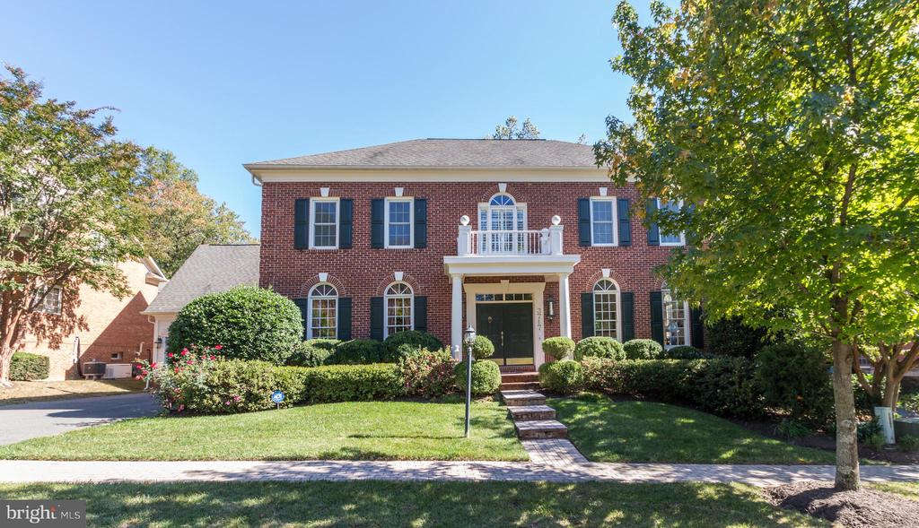 Elegant and Spacious 3 level brick Colonial Estate with 5,336  square feet of living space. Features 5 bedrooms with two offices, 4 full and 2 half baths, fully finished basement, 2 car garage and heated in-ground pool. Conveniently located within a quiet enclave of luxury homes in Chevy Chase just across from the newly redeveloped Chevy Chase Lake Shopping Center and the new Purple Line Metro.This exquisite home offers absolutely everything the discerning homebuyer would want.  Well maintained with tons of thoughtful upgrades throughout.  The home features a tremendous amount of storage throughout with numerous custom built-ins that convey with the home. Upon entering the home, the formal dining room sits to your left and the formal living room sits to the right boasting a cozy gas fireplace. A Grand Entry foyer leads to a large family room appointed with a gas fireplace, built in bookshelves and entertainment cabinet and twin sets of elegant French doors offering direct views into the lush green backyard and flagstone patio.There is an office/den located on the main level with a half bathroom just outside.Gorgeous hardwood floors add an elegant richness to the entire first level as well as the stairs and top level hallway. The main level features 10~ ceilings throughout the living room, dining room, family room, kitchen and sunroom areas for an airy open feel. A grand sunroom is located off the kitchen and offers year round sunlight and views of the garden and pool. Two windows in the sunroom were recently replaced. Both the living room and sunroom walk out to the large flagstone patio encased in brick.The huge Gourmet entertainers kitchen features stunning blonde cabinetry and light Corian stone counters with a cool tile floor. An extra wet bar, counter space, cabinetry, wine cooler and large center island add plenty of room for a true entertainer~s kitchen. Create amazing meals in the kitchen and walk right out the back to the elegant flagstone patio for al fres