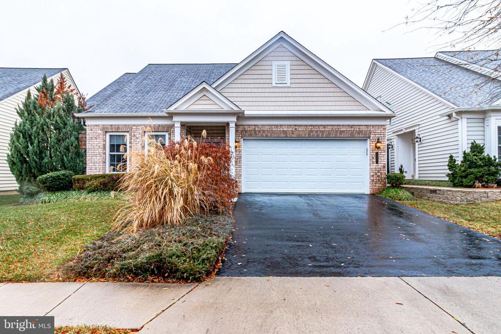 BACK ON THE MARKET!!! Open House this Sunday from 1-4pm on January 26th, 2020! Seller has moved out and property is now vacant for agents to Go and Show. RARE OPPORTUNITY for this beautiful home with upgrades GALORE in Potomac Green, the premier 55+ community. Open sun-filled floor plan with 3 bedrooms and 3 full baths, with Hickory hardwood floor on main level. Master bedroom on main level for EASY ACCESS. Office suite/library can be 4th bedroom. Loft level is perfect for guests or a quiet retreat. French doors lead out to heavily landscaped yard with brick patio. Amazing CUSTOM garage with built in storage, overhead bins and a rubber floor. Short walk to clubhouse/ Loudoun One. Home is set at an UNBELIEVABLE price in this high-in-demand neighborhood. Don't miss your chance!Come and take your loved ones to bask in the WARMTH and COMFORT of your new home. Open House on January 5th, 2020 from 1-4pm!