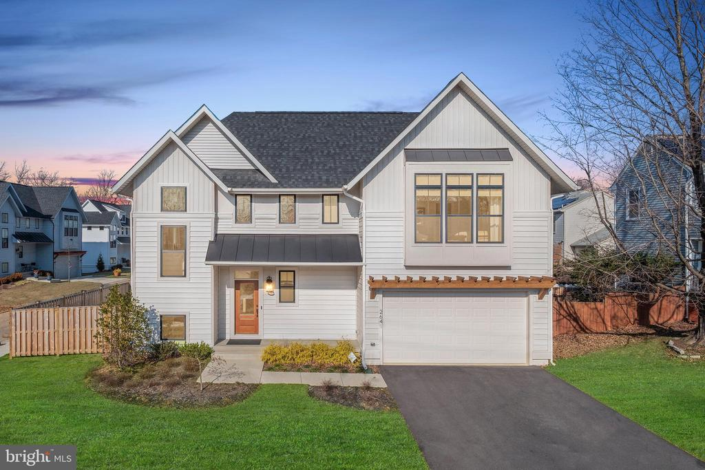 This Must See Home Showcases Modern Comfort and Luxury against a Bright & Airy Canvas - with Oversized Rooms, Extra-wide Hallways & Staircases, High Ceilings, and Floor to Ceiling Windows. Built in 2018 by OPaL Builders, this Model Home offers Tons of Upgrades Including: Designer Paint & Wall Finishes, Custom Window Treatments, Smart Music & Lighting System, High-end Appliances, Modern Light Fixtures and Plush Carpeting. The Gorgeous Open Floor Plan boasts Soaring Ceilings, Hardwood Floors with a Contemporary Stain, Recessed Lighting and an Abundance of Windows Throughout. The Gourmet Kitchen is at the Heart of the Main Level and features Designer Countertops, Stainless Steel GE Appliances, Soft Close Custom Cabinets, Subway Tile Backsplash, a Pantry and Large Island with Sink & Breakfast Bar. The Kitchen Seamlessly Merges with a Spacious Living Area offering a Gas Fireplace, Floor to Ceiling Windows and Walk-out to the Deck and Fenced Backyard. The Stunning Dining Room is Surrounded by 3 Walls of Windows with Walk-out to the Deck. ALL Bathrooms Epitomize Modern Design and Function with Subway Tile, Designer Vanities and Faux Slate Tile Flooring. The Sizeable Master Bedroom offers Cathedral Ceilings, Designer Wall Paper and a Room-sized Walk-in Closet. Relax in the Spa-like Master Bath with Soaking Tub, Separate Shower, Dual Vanities, Lighted Mirrors, Subway Tile, and Modern Tile Flooring. 3 Additional Bedrooms with Attached Full Baths, a Laundry Room with Front Loading GE Washer/Dryer and a Walk-in Linen Closet can be found on the Upper Level. The Lower Level offers a 5th Bedroom with Full Bath plus a Spacious Rec Room finished with Shiplap. Additional Features Include: Attached 2 Car Garage plus Mudroom, Dual-Zone HVAC and Fully Fenced Backyard. Great Location - Walk to Metro and Westfield Mall. Easy Access to University Blvd and Georgia Ave. Don~t Miss this Rare Kensington Offering.