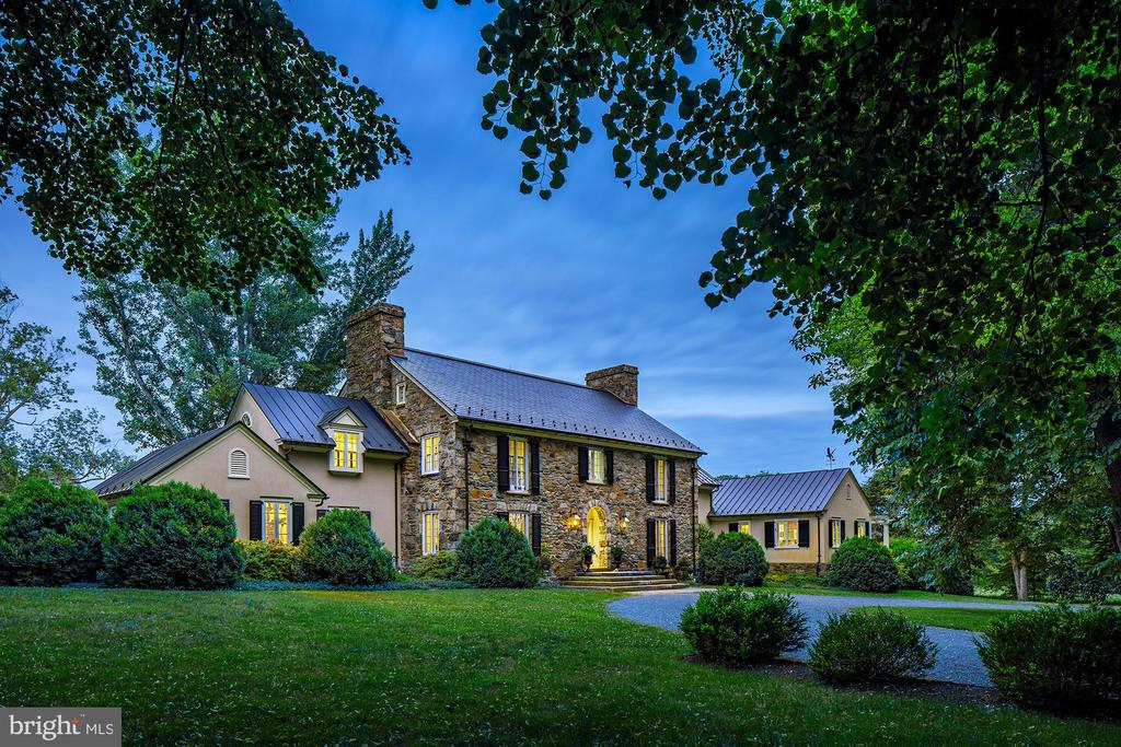 In a premier Foxcroft Road location approximately one mile from the Middleburg town center, this circa 1926 stone manor house has been tastefully and painstakingly restored and expanded, creating a superb blend of the historic and traditional with elegant day to day living space. The main residence is approximately 8600 square feet, with 6 bedrooms and 6 full and 2 half baths and 8 working fireplaces. The grounds are professionally landscaped and include exquisite formal gardens, orchard, carriage house with full bath, pool and pool house with bath and kitchen. On 22 acres, the property also includes a stable/barn area with separate state road frontage access. There is a main barn with 6 large box stalls, heated wash stall, tack room and extensive machine and upstairs storage. There is a second 2 stall barn with tack room and 1 bedroom tenant cottage. There are 8 fenced fields with 4 smaller paddocks with 4 large run in sheds with water and electric that may also be converted to stalls. All systems and construction are top of the line and very well maintained. Other property particulars include: main residence 4 bay side entrance lower entry garage, slate roof main residence, copper guttering and downspouts, 5 acre invisible fencing, security system with camera surveillance, whole house sound system, emergency generator system, central vacuum, heated bathroom floors, extensive underground drainage system, central vacuum, and water purification system. The entire property and improvements are in excellent condition. In land use, Seller shall not be responsible for roll back taxes if any.