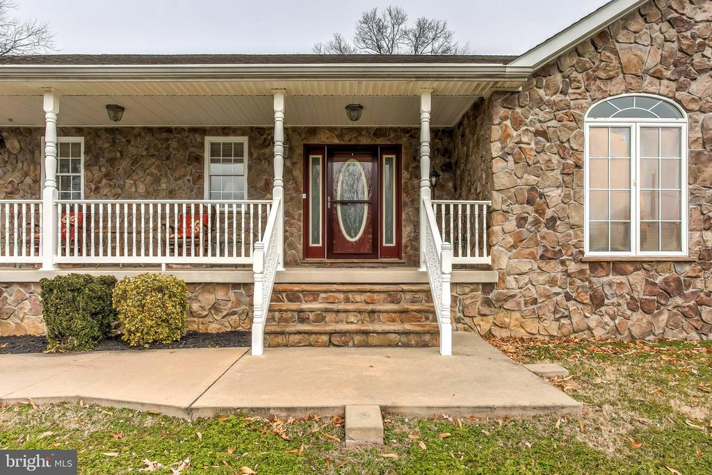 Come explore this extraordinary 3 bed/2 bath gem of a stone rancher.  Just minutes to Trade Point Atlantic,  Amazon and down the street from Young's Boat Yard.   Bring the big screen TV and the big -L- shaped couch, it will fit perfectly in this 17-21  spacious living room.  Off the living room is the master bedroom including the master bath with soaking tub for two.  Also off the living room is the 3rd bedroom currently used as an office.  And never miss a beat with the family as the living room opens to the large eat in kitchen with fabulous counter top space, breakfast bar and beautiful stainless appliances. The kitchen then opens to an expansive covered deck, that leads you to a vinyl fenced rear yard.  A perfect space for BBQ's with friends & family.  You'll love the long, recently paved  driveway that leads to a 3 car garage plus huge parking pad. Set up the workshop you've always wanted. Make an appointment today!  Open House on 1/12 has been cancelled.