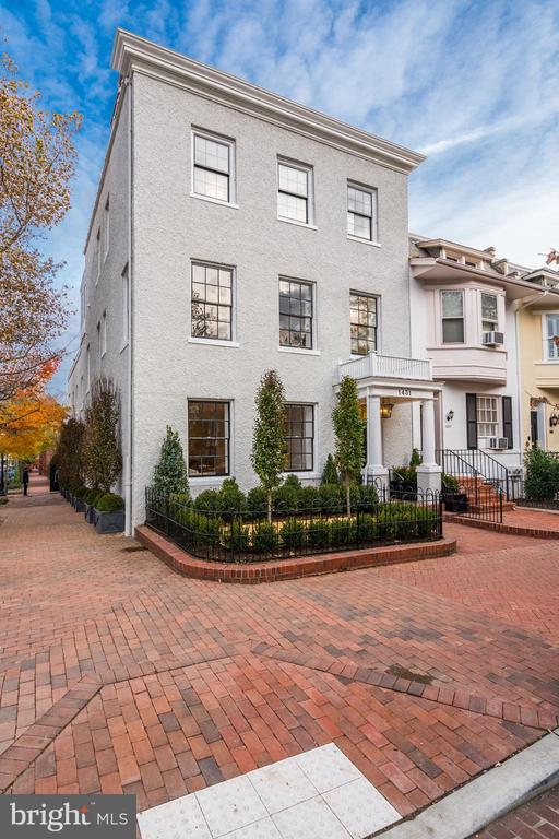 Completely renovated from top to bottom by DC's renowned developer John Cecchi, this beautiful Georgetown home offers high quality, modern finishes. The main level features a Foyer with herringbone hardwood floors, Living Room with marble wood-burning/gas fireplace, Formal Dining Room, Powder Room, Family Room with shiplap walls and access to an outdoor patio,  Kitchen with large center island, stainless steel Wolf appliances, Subzero refrigerator, wine cooler, and Waterworks fixtures. The second level features the spacious Master Bedroom with his and hers closets, Master Bathroom with marble tiling, soaking tub, and Waterworks fixtures. Two additional bedrooms with en-suite bathrooms and walk-in closets complete this level. The top floor offers two bedrooms with en-suite baths, Wet Bar, and spectacular Roof Deck with views of Georgetown. The lower level has 1 Bedroom and full bath, Recreation Room, and Laundry Room. This home also includes an elevator that serves all four stories. One Car Garage included.
