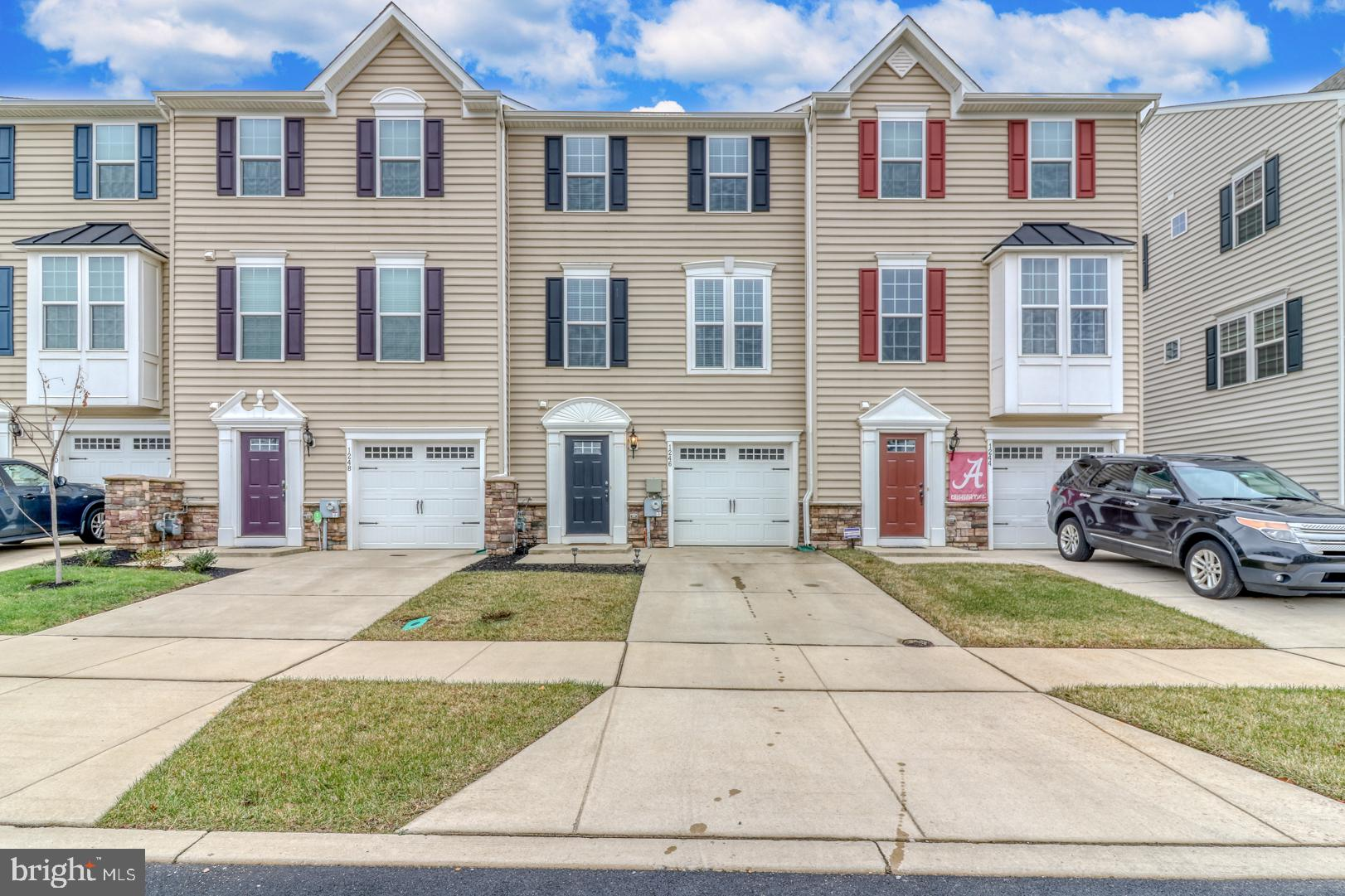 Fantastic opportunity to own an almost new three bedroom, two and a half townhome in desirable High Hook Farms. This home offers a completely neutral palette allowing you to move right in and put your personal touch and taste on every room! While located in Appoquinimink School District, enjoy the premium East Middletown location offering easy  access to Rt. 1 and 13.  Every level of this home offers spacious living space including the first level with interior access to the one-car garage, a powder room, a large media room or potential bedroom with French door to the back yard and large storage closets. Make your way to the main level with an upgraded and modern eat-in kitchen featuring upgraded 42 inch cabinets, granite countertops, an eat-up breakfast bar open to the family room, a large center island and stainless steel appliances. French doors lead to an over-sized maintenance free composite deck ideal for your summer BBQ's. The family room is wide open, filled with natural light and the perfect space for entertaining. Head upstairs to the third level where you will find a large master bedroom with stunning tray ceiling, a generous walk in closet and master bathroom with a double sink vanity, tile flooring and ceramic tile shower surround which was an option during the build process. This level also consists of two additional bedrooms and hall bathroom. Laundry is a breeze with a convenient upper level washer/dryer. All appliances are included! This home is energy efficient and move-in ready. Schedule a tour today!