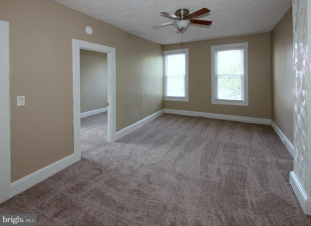 Great opportunity to lease this spacious, renovated, 2 bedroom + den/office in convenient location near John Hopkins.  This apartment in 2 unit building, features private entrance, full washer and dryer, closet and storage space, newer appliances and more.  Tenants responsible for all utilities, pets on case by case basis.  Vouchers welcome.