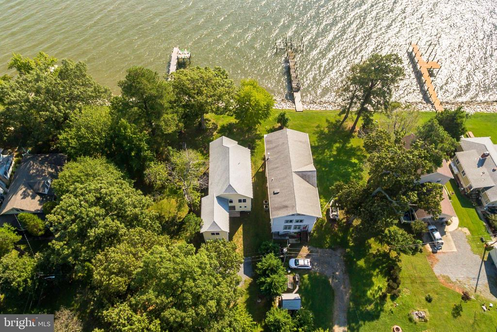 Live directly ON THE CHESAPEAKE BAY! Brand new contemporary home with genuine hardwood floors, huge master suite with separate tub & dressing room. Spacious  double lot that goes from Walnut Ave to the Bay.  50 feet water frontage. Trex deck off the family room & balcony off the master overlooking the water. Huge upstairs family room above garage too. Your waterfront dreams come true here! Lot goes out to Walnut Avenue so no other houses will be built close by. Giving you lots of extra parking! Why buy an old resale when you can have BRAND NEW!