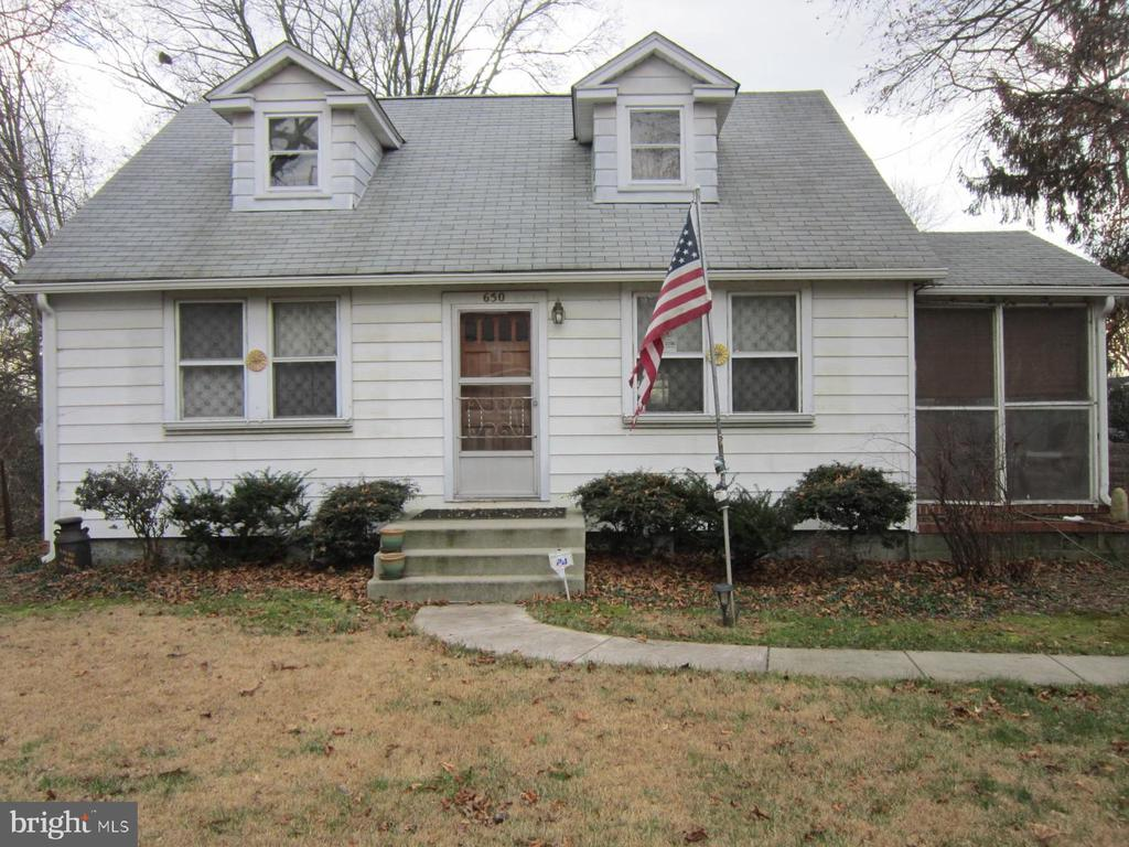 "Cape Cod, being sold in ""As Is"" condition.  Hardwood flooring, enclosed side porch, basement, and huge fenced-in backyard.  Central Air on the first floor.   Priced right for a quick sale.  A great opportunity for a flipper."