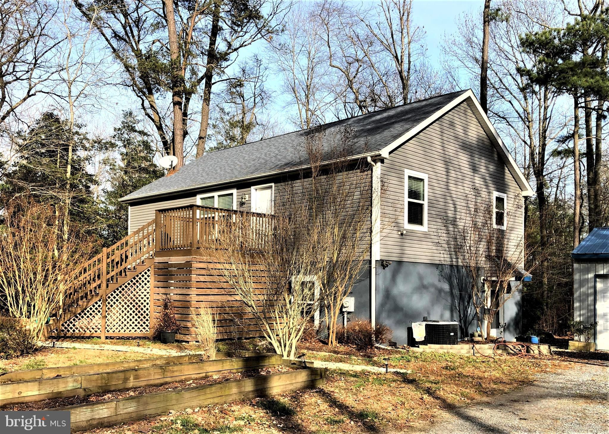 """Do you say, """"I want a home with no homeowner's association!""""   Do you say, """"I want privacy!!""""   Do you say, I want to be close to the beach!!!""""  Okay, then... here's your opportunity!  This three-bedroom, three-bath two-story Raised Rancher has the possibility of splitting up the first and second floors  (with some modifications) to make an upstairs/downstairs duplex out of this home.  Located just 7 miles to Lewes Beach, and only 5 miles to Rt. 1 via Rt. 24, this property is situated on .64 acres and is perfectly located to be """"close, yet far enough away from the beach""""!  You are able to keep your property as natural or as manicured as you'd like because there is NO HOA to tell you what to do!!   And the front second-story deck and the rear balcony afford views of wildlife that will amaze and delight you.  With spacious rooms throughout, this home was built with extra insulation on purpose.  Stainless-Steel Appliances complete the kitchen upgrade done in 2018.  A large utility closet downstairs for the systems of the home (HWH new in 2019) and lots of storage.  This house offers so much to the right buyer... is it you?  Book your appointment today to check and see."""