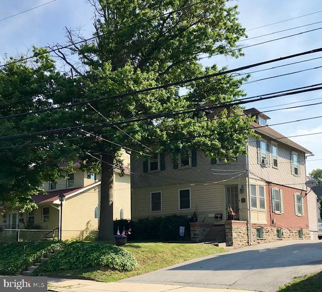 Take advantage of this perfect investment opportunity! A well maintained brick Victorian duplex located in the award winning Interboro School District. The home has so much to offer with a spacious front yard, nice side yard, private covered rear porch, large driveway with parking for 3 vehicles and detached 1 car garage. With a projected generated gross income of $24,300 annually, also with additional annual income available when renting detached garage. Separate utilities with tenants paying gas, heat, electric and water after meter readings. Both units are currently rented on yearly lease agreements. With very good tenants. Shared front enclosed entry vestibule with separate unit entrances. Apartment 1 is on the first floor and features: central air, two nice sized bedrooms, large living room, eat in kitchen, refrigerator, microwave, dishwasher, full bathroom, gas fireplace, private rear covered porch, basement access to laundry and plenty of basement storage. Also has its own private rear entrance on rear porch! Apartment 2 is on the second floor and features: window AC units, two bedroom, large living room, eat in kitchen, refrigerator, microwave, dishwasher, full bathroom, exterior access to laundry and a full walk up attic with plenty of storage space. Appliances stay in ~As is~ condition including refrigerators, window air conditioners and coin operated washer/dryer. Conveniently located two blocks from the Septa Railway and Prospect Park town shopping. Also just a short drive to Center City, Sports Complexes, I95 and the Philadelphia International Airport.