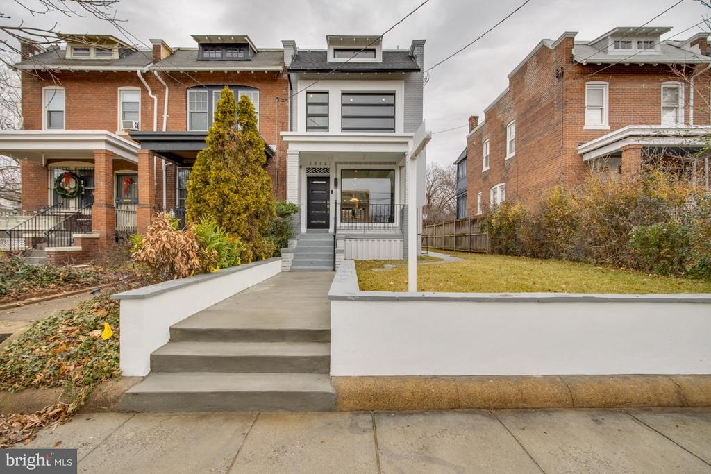 Stunning thoughtfully designed contemporary row home in the sought after neighborhood of Brookland! This state-of-the-art property is one to be admired w/ countless details throughout. End unit, featuring 4 beds, 3.5 baths within 3 completely renovated levels. Beautifully built coffered ceilings in a spacious open-concept living space beckons entertaining and enjoyable family living. High-end kitchen complete with all new top-notch SS appliances, quartz countertops, waterfall island, modern cabinets, and more! The 2nd level features custom 8ft doors, high ceilings, and a skylight that adds sophistication and abundant natural light. The master suite showcases high vaulted ceilings, a walk-in closet, and an exquisite master bath w/ a designer soaking tub and custom European tile. The lower level suite is perfect for nanny/in-laws or supplemental income stream. Elegant touches throughout! Chic french doors lead to a large deck that's great for outdoor dinning! New two car parking pad for easy off-street parking. This one is a Must-See!