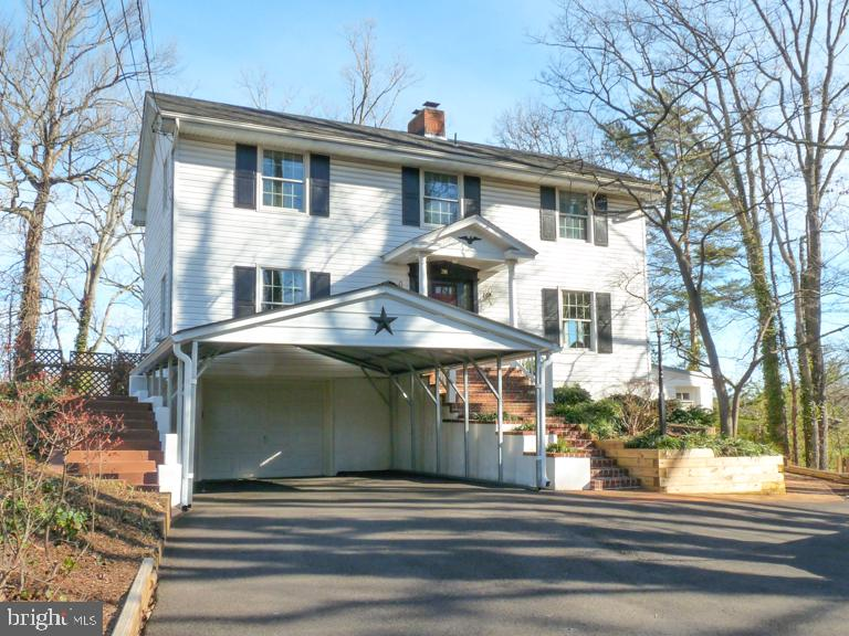 OPEN SUN JAN 26 1-3 PM! The one you have been waiting for! Beautiful waterfront home on Weems Creek!  Enjoy the Annapolis waterfront lifestyle including... waking up to a gorgeous 180 degree water view, relaxing on the screened back porch, working and dining overlooking the water, and boating from your own private 25' deep-water pier with multiple slips, a boat lift, electricity and fresh water.  Numerous features include gourmet kitchen with island, hardwood floors throughout, water views on every level, 4 bedrooms, 3.5 baths, huge deck. Marvelous Admiral Heights community amenities include a pool, pier, boat ramp, parks, clubs, and social events!