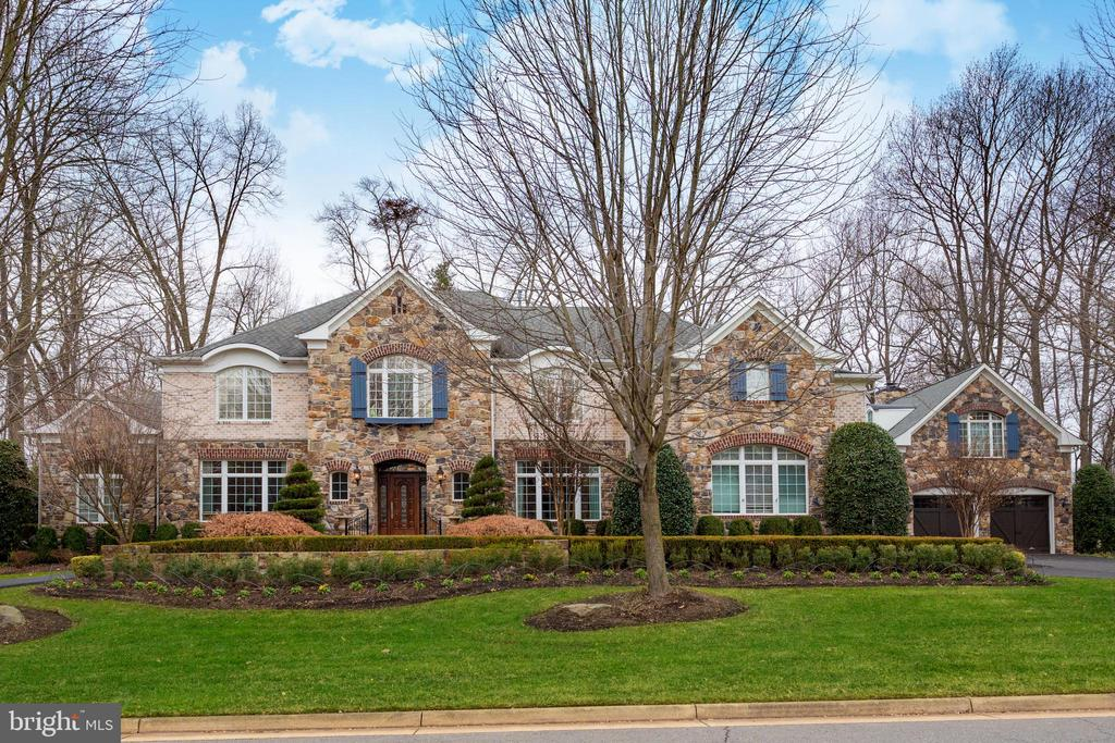 Mansion sized French Country in sought-after, Symphony Meadows, enhanced in so many ways after being built! Truly an amazing home with a $1,000,000+ in upgrades! Separate carriage house includes a 4th & 5th garage with an upper level in-law suite/guest house with full bath & refreshment bar, plus a pavilion room-screened porch with fireplace surrounded by outdoor amenities; Iron fence surrounding the backyard, brick paver patio, cook-station, Oasis-style swimming pool, waterfalls, extensive up lighting & meticulous landscaping. Paved Driveway (2019). Inside, room after room of luxury interconnect featuring; 2-story foyer with curved staircase, formal living room & dining room, light filled Vista room, Author's library, 2-Story Great room with Cast Stone fireplace, Fine Arts Chandelier & wall sconces, casual dining area plus an incredible renovated Chef's kitchen (2016); cabinets, counter tops, Wolf range, 2 Sub Zero fridge/freezer, microwave, dishwasher & chandelier. Upstairs, is the apartment size master suite with fireplace, ultra bath & huge walk-in closet, plus 3 bedrooms & lounge area. The lower level is perfect for entertaining with an esquire style vintner's lounge, bar, wine vault, rec room with fireplace, huge exercise room & Office/Den. Refinished hardwood floors (2016) & updated crown moldings throughout, PLUS WHOLE HOUSE GENERATOR!