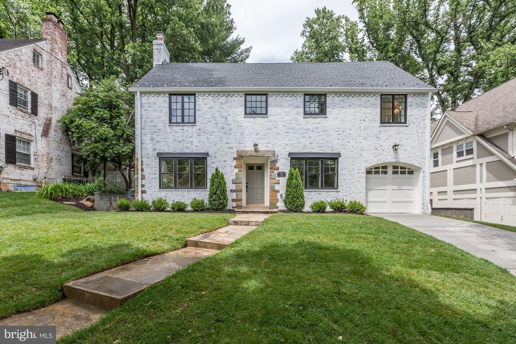 Nearly 4,900 square feet over 4 levels in this spectacularly renovated home with architectural enhancements and elegant finishes throughout! The thoughtful floor plan includes a beautifully appointed living room with wood burning fireplace and formal dining room and with a spectacular butler's pantry.  The gorgeous, open-concept kitchen has a spacious quartz island with breakfast bar. This chef's kitchen features top-of-the-line appliances and striking brushed-gold details. The adjacent family room is generously-sized and ideal for entertaining. A convenient mud room with built-in storage and half bath are additional main level features. The Owner's Suite with tray ceiling and luxurious en suite bath with marble accents is sophisticated and spacious. Three additional bedrooms, one with an en suite bath, are well proportioned and the laundry room on this level is a bonus.  The sprawling lower level provides an additional bedroom with a shared bath, an exercise room, game room and family room with built-in bar.  This truly stunning home is ideally located on a tree lined street close to everything Chevy Chase, Bethesda and D.C. have to offer!