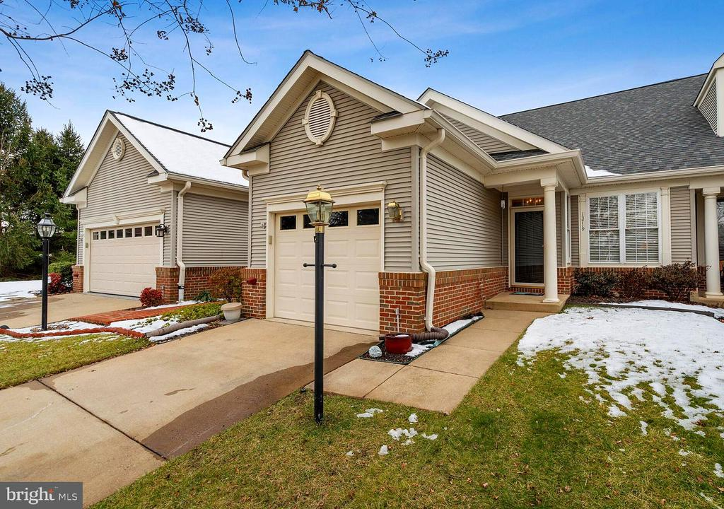 Located in Award-Winning Active Adult (age 55+)Community of Heritage Hunt**This 3 bedroom attached villa home has been lovingly cared for by original owners** Main level entry into living room and dining room**Kitchen has Corian counter tops**Gas cooking**pantry**Newer Washer and Dryer convey**Gas fireplace in family room which has sliding glass doors to a lovely large deck**Large master bedroom with Master Bath and a 1/2 hall bath complete the main level interior** The upper level has nice loft area**2 very large bedrooms**another full bath**and floored storage room**Nice private location