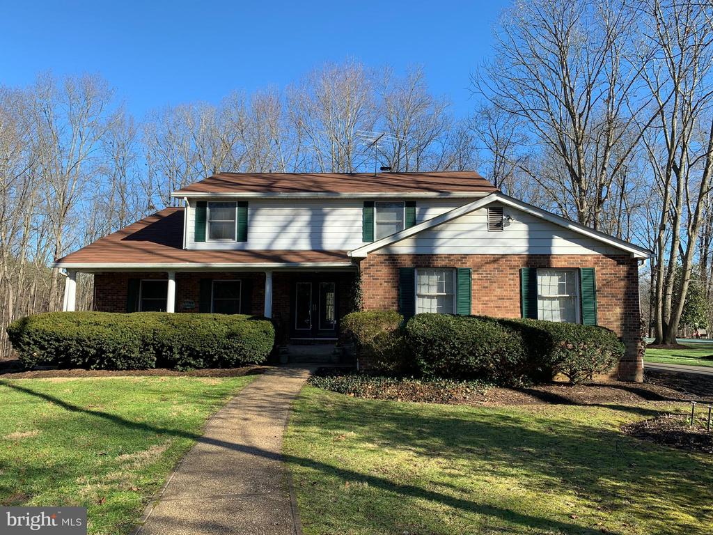 """This 4 BR, 3 BA, custom-built colonial is nestled on 12+ private, mostly wooded acres with the property bordering Bull Run Creek. One acre around the house is cleared and landscaped with beautiful hardwoods, mature perennials, and flowering shrubs, and includes a heated in-ground pool and a 900 sq/ft 2-story barn w/electricity. The main level floor plan is perfect for entertaining, with a formal living room, dining room, and a large eat-in kitchen w/bay window and accesses to the sunroom. The family room is also used as a library w/brick fireplace and built-in shelves. The upper level offers an updated master suite with a Finnish sauna, a separate shower, garden tub, and double vanity. Special features include crown molding, recessed lighting, hardwood floors, etc. The finished walk-out basement includes a recreation room w/fireplace, a wine cellar and two dens which could be used for craft and/or media rooms, as well as plenty of storage space. The house is equipped with a whole house fan and a whole house generator. Updates include HW heater, dishwasher, and french drain in 2019; new roof in 2018; brick walkway, patio, and driveway paving in 2015. The CAC and propane gas heating system, barn roof and the laundry room have been replaced/renovated less than 15 years ago. The public records show that the house was built in 1985, but conflicting information suggests an earlier construction (prior to 1978). The owners choose to sell their home """"as is"""", but the buyer is free to have it inspected for their information only."""