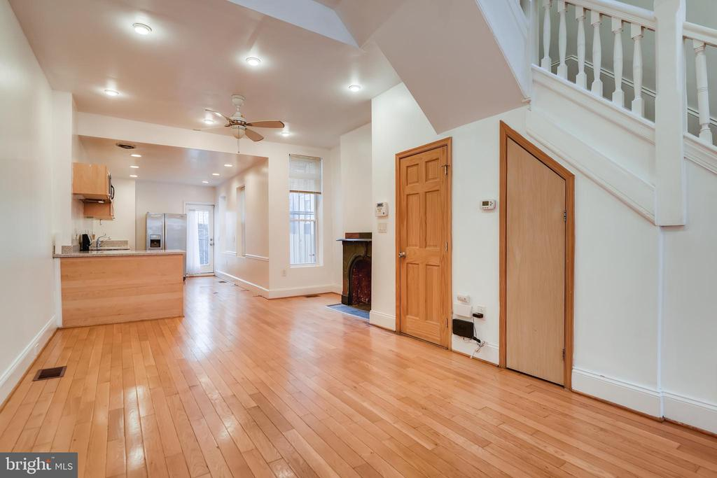 Pristine row home full of wonderful original character in historic Reservoir Hill! This home features over 12' ceilings and tons of natural light! Wood flooring throughout the entire home! First floor is a great sized open concert w/ a wood burning fireplace an updated kitchen. Rear door leads out to the fully fenced rear deck and patio, perfect for entertaining! Second level has 2 spacious bedrooms, full bathroom w/ separate vanities, and upper level washer/dryer!  Generous master suite located on the third floor w/ a large den and sliding glass doors to add a possible rooftop deck. Enjoy the exposed brick and all of the benefits this home has to offer! Close proximity to bus lines, MD Zoo, Druid Lake,  and shopping areas! Perfect home to add to your investment portfolio during the massive developments happening in Reservoir Hill and Druid Hill Park!