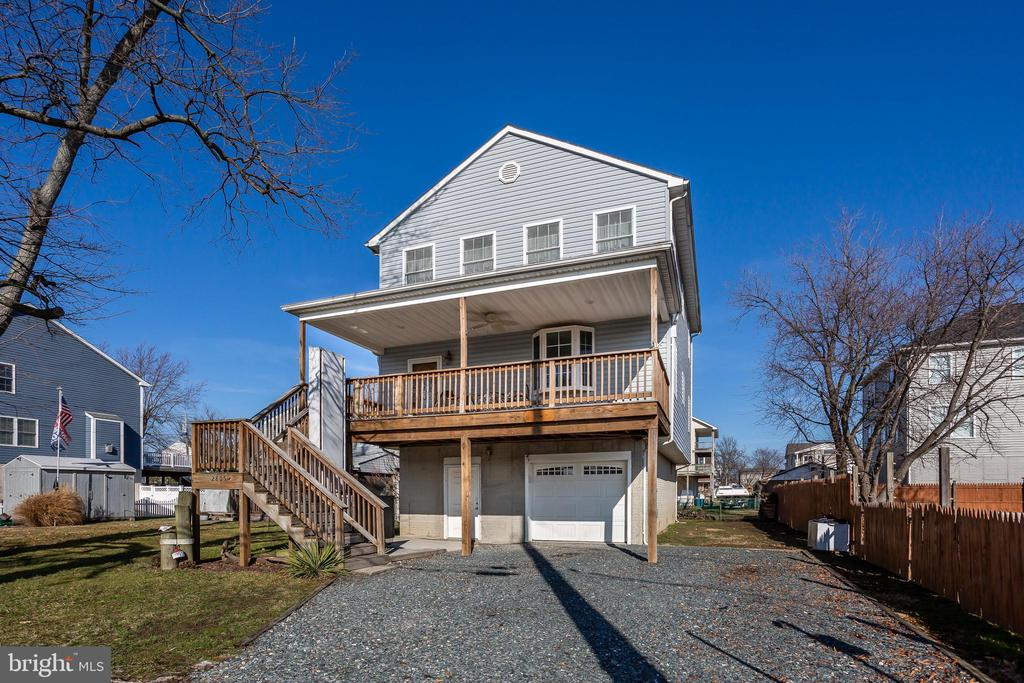 This custom built 4 bedroom Coastal Colonial with attached garage, new carpet, fresh paint, main floor bedroom, and a spacious private master suite with an enormous walk-in closet features amazing panoramic views of the Chesapeake Bay and Back River.  The large, open concept living area has a sizable kitchen with breakfast bar and ceramic tile floor, and a wood stove (with a supply of wood and safety gate). A main floor guest bedroom can also be used as a home office or main-floor master.  An HE washer and dryer are located on the main floor for convenience. With the basement garage, there is plenty of storage space plus room for your car, truck, bike or SUV. Enjoy the sought after Millers Island lifestyle! With multiple public access points to the river, it's so easy to enjoy activities such as canoeing and paddle boarding.  An exterior elevator/lift is also in place, but can be removed prior to settlement, if desired.