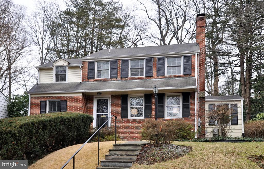At last.  A 4BR/3.5 BA Wood Acres colonial with a two story addition on the back.  It features an open large Kitchen w. granite tops leading to a private rear patio. There are two more dens on the first floor as well.  Upstairs there are FOUR bedroom and two renovated baths.  The lower level is fully finished and includes a 2015 Full bath and a 1-car garage.  Updates include all windows, 2018 gas Furnace & hot water heater.  This home is a short walk to the splendor of Wood Acres Park which is adjacent to sought after Wood Acres Elementary.  The classic colonial is located on a quiet street just a block to bus service on Mass Ave. as well.  OPEN 3-5 SUNDAY.