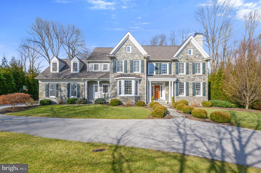 This home is the true definition of a Main line dream house. Located in the estate section of Devon, convenient to Wayne, Newtown Square and the R5 train line, you will love the conveniences of this fabulous location. Immediately, the curb appeal will WOW you. The stone front and beautiful approach are what makes you fall in love with this home on a private cul-de-sac. Nearly 6800 square feet of living space on a one acre lot at end of the cul-de-sac. Wonderful stone  colonial with 5 bedrooms, 5 full baths and 2 powder rooms. Features include site finished oak flooring, extensive millwork throughout, 3 fireplaces; gourmet kitchen with center island, granite countertops, Viking appliances, cherry cabinets; separate breakfast room; butler's pantry with granite, wet bar and Viking wine cooler; striking master suite and bath; 3rd level finished as a private suite with full bath; finished walk out lower level with expansive game room, full bath and a wine cellar; beautiful flagstone rear patio with matching stone fireplace and knee walls; professional landscaping, flat walk out back yard that is fenced in is perfect for entertaining or sports for the kids. This home has been very well cared for and it shows.