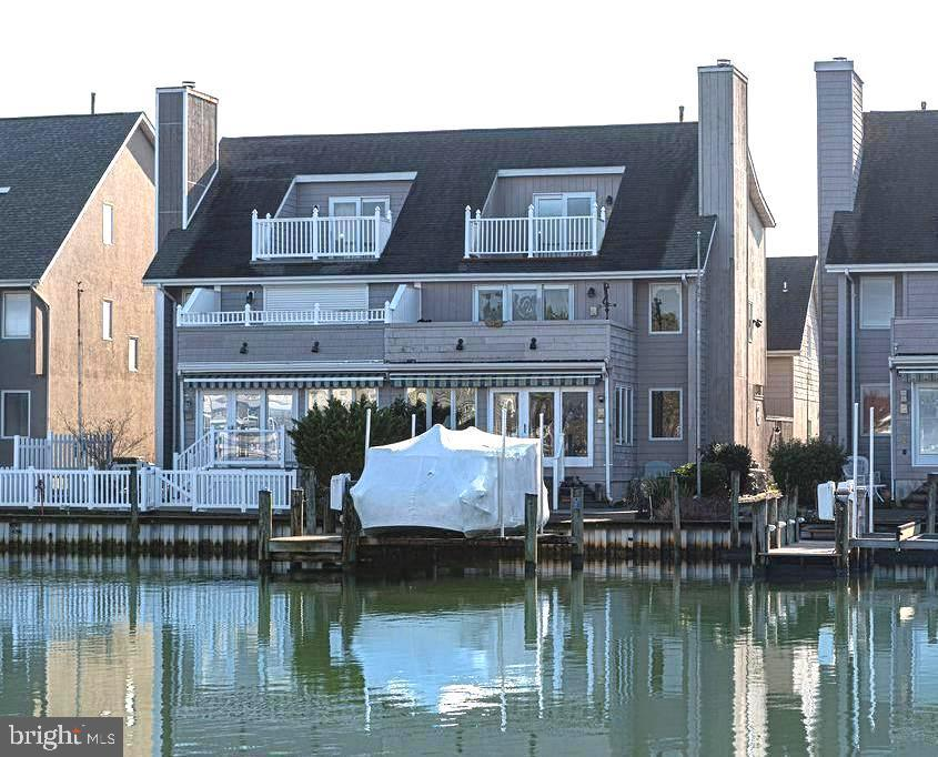 "GREAT OPPORTUNITY - Now Available, luxury waterfront 4 bed/4.5 bath townhome, approx. 3,538+-sq. ft.,  multiple updates thru'out. NO CONDO FEES! Dock w/lift, easy access to open deep water.  Views to a park from each level in this gracious owner-occupied residence.  A private entrance thru gated patio takes you to 1st floor living rm w/fireplace, dining, spacious kitchen w/island, breakfast area, built-in desk, powder rm.  Hardwood floors thru'out.  Gourmet kitchen includes JennAir down/draft range, double wall ovens, Corian counters, pantry.  Convenient access from 2-car garage to laundry and 2nd of two staircases (back one has chair lift!)  Enjoy the  all-season waterfront sunroom w/sliders to deck, dock with  park view!  The ""split"" staircase to upper landing opens to an amazing flex space for you ( now a great room/study/and or 4th bedrm/bath) and includes 2 master bedrm suites with 2 full baths, a 2nd full kitchen, waterfront balcony, back staircase to 1st floor.  Bonus third floor features private bedroom/sitting area, full bath and another waterfront  balcony!  Multiple zone HVAC's (3),  including 2 ""Apollo""/hot water combo units,  central vac, Pella windows,  intercom!  This home is perfect just for you and with room for more !"