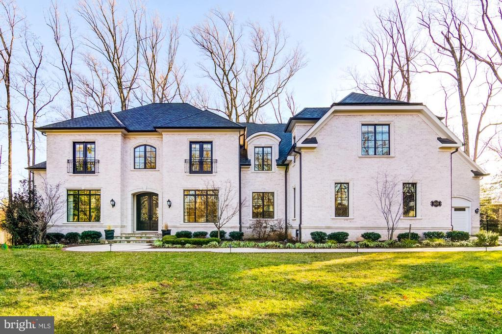 Open House Sunday 2/16 - 2 to 4pm- Privately set back in McLean, this 7 bedroom home with 7 full baths, 3 half-baths and 11,000+ square feet of finished living space. The three-story white brick estate was built in 2014 and sits on nearly an acre of a perfectly landscaped lot. Upon entering, you are greeted by a two-level grand foyer with a balcony and marble floors. The main living area consists of flawless millwork, walnut floors and stone accents. Adjacent to the living room is a formal dining room, as well as a family room with a double-sided gas fireplace with limestone surround. The open spaced kitchen has a large breakfast room with floor-to-ceiling windows and sliders to the deck. It also includes an enormous prep/breakfast island, marble counters, white custom cabinets and upscale appliances which contribute to an amazing meal experience! There is a library, mud room, lower laundry room, garage entry and a lovely bedroom suite with bath, sun deck and private entry~ideal for guests or in-laws. The upper level has five more bedroom suites, each with an en-suite bath. The Master Bedroom includes a large sitting area with coffee bar, kitchenette, gas fireplace, two walk-in closets and a covered balcony. An exquisite spa bath features two marble vanities, a makeup table, Italian porcelain tile and a separate soaking tub and walk-in frameless shower. Also noteworthy is the upper level laundry room!If all this isn~t enough, there~s a four-car attached garage and a giant finished basement that includes a bedroom suite with full bath, a billiards room, recreation room, exercise room, office, wet bar and hallway powder room. Stepping outside, the surrounding land is showcased with patio, deck, custom fire pit and a lighted sports court! It~s a perfect place for parties and other social events, or simple family fun!