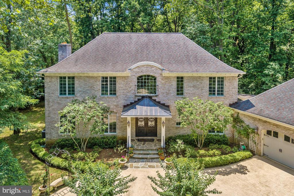 Open House Sunday 1/26, 1-3PM.  Annapolis Waterfront. Custom built brick French Colonial on 1.8 acres on Crab Creek/South River. Bring your boat, new pier with 5' MLW and no bridges to the Bay. Bright open floor plan with high end finishes throughout this modern home including hardwood floors, imported limestone two-story entry foyer, iron double entry front door, 3 piece custom moldings, wainscotting on both 1st & 2nd floors, granite and stainless steel. Gorgeous eat-in kitchen with 6 burner Wolf stove & hood, Sub-Zero refrigerator plus 2 cooling drawers, wine cooler, dual sinks w/garbage disposals, Miele coffee bar, double drawer dishwasher and great view of the water & new pier. Master bedroom features deluxe bath w/steam shower, twin (his & hers) zoned heated floors, twin (his & hers) walk-in closets, hardwood floors, fireplace and balcony overlooking the water. Main level bedroom with private bath. Large 2nd floor laundry room that could be 5th bedroom. Covered back porch overlooking the water, oversized 2 car garage with tons of storage in built-in lockers plus there is an unfinished lower level with ruff-in for full bath. Great location for getting out to Rt 50 & I97 but close to all the activities in Downtown Annapolis. Private and peaceful setting.