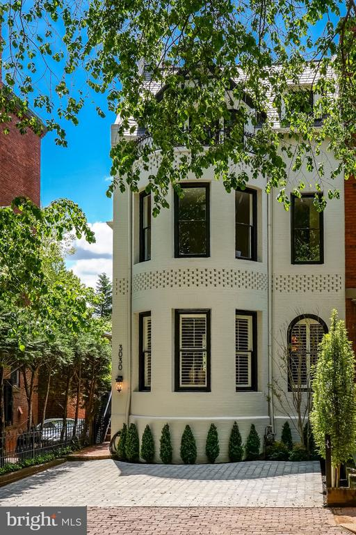 Please call listing agent, Jamie Peva, 202.258.5050 for a CDC compliant showing during the open house hours of 1-3 on Sunday 8/9/2020. Turn Key!! No detail has been overlooked, no surface has been left untouched during the two year renovation of this gorgeous 5 Bedroom, 5.5 bath East Village Residence. This is a true Linda Battalia Renovation, and exemplifies the attributes that she has become well known for. By using the highest quality materials and the finest workmanship, she has designed a residence that fits the 21st century lifestyle. The main entrance opens to an elegant foyer which leads to the spacious living room/dining room on one side and the comfortable family room on the other. The eat-in kitchen has top of the line appliances and opens on to the private, south garden. The upper level has a luxurious master suite with bath and dressing room. There is also a second bedroom with en suite bath, as well as a study. The top level has two more bedrooms, each with its own bath and a laundry room. The lower level, with a separate rear entrance, has a private bedroom suite, a large and sunny recreation room, a large storage room, and a generous utility room. The driveway is generous, space for 2 cars plus.