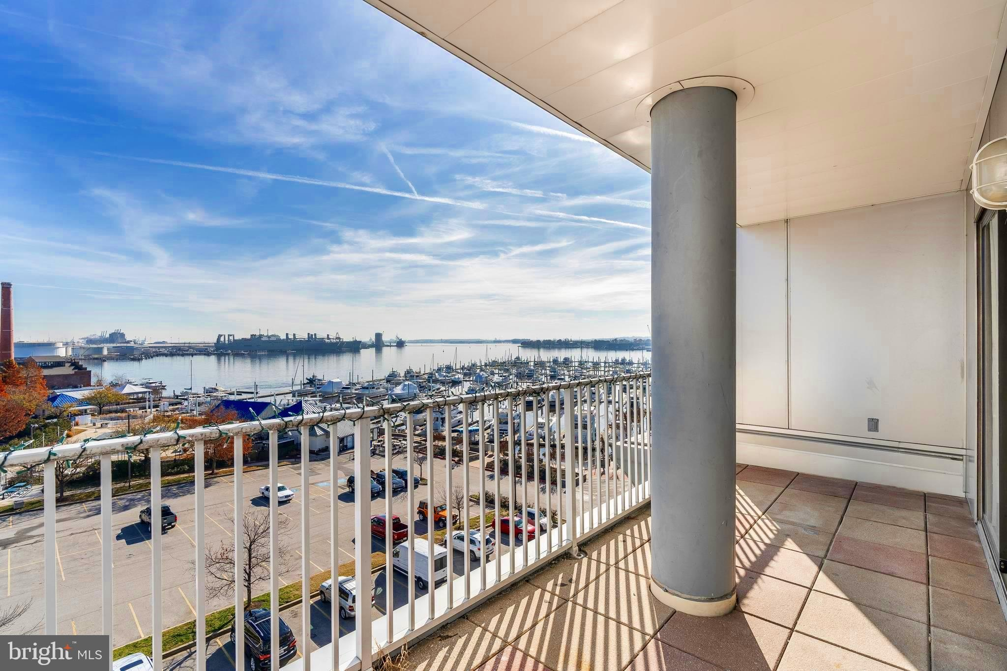 If you are in the market for a SUNDRENCHED  condo in a 24-hour SECURE building, you must check out this beautifully updated 5th floor condo with a SPECTACULAR view of the Marina and the City beyond.  A QUIET sophisticated building close to all Canton amenities.  Beautiful new flooring and neutral paint, granite and stainless kitchen,  Covered parking.  20' long Covered Balcony with enchanting Marina views.  Very spacious bedrooms share the Marina views.  Very large walk in closets in each bedroom.  Two generous full  baths with new vanities and tops. Full size washer/dryer. Absolutely move in ready!  BEST VALUE IN CANTON.   Make this your home for the New Year!